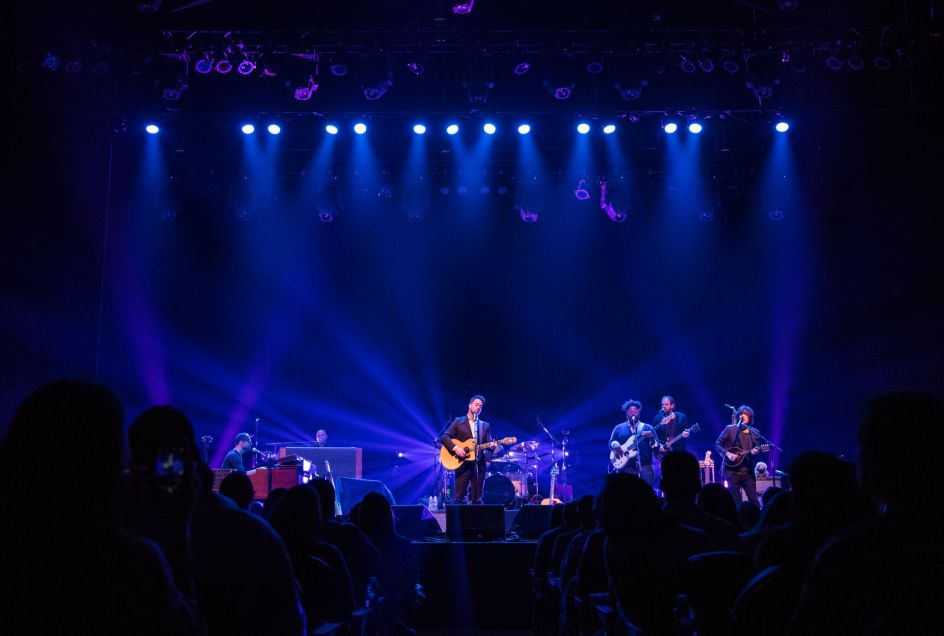 Amos Lee on stage during the concert for Immersive Entertainment for Hospitalized Kids
