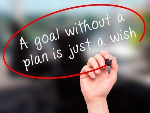 """Man Hand writing """"A goal without a plan is just a wish"""" black marker on visual screen. Business, technology, internet concept."""
