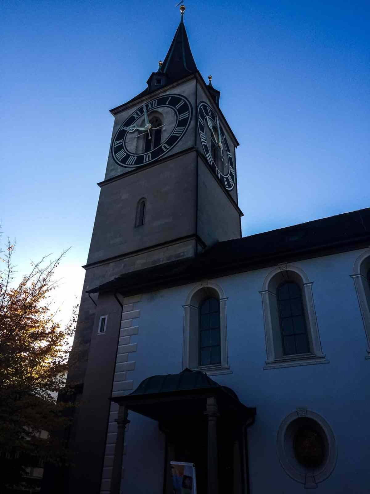 zurich in one day - city clock tower at dawn