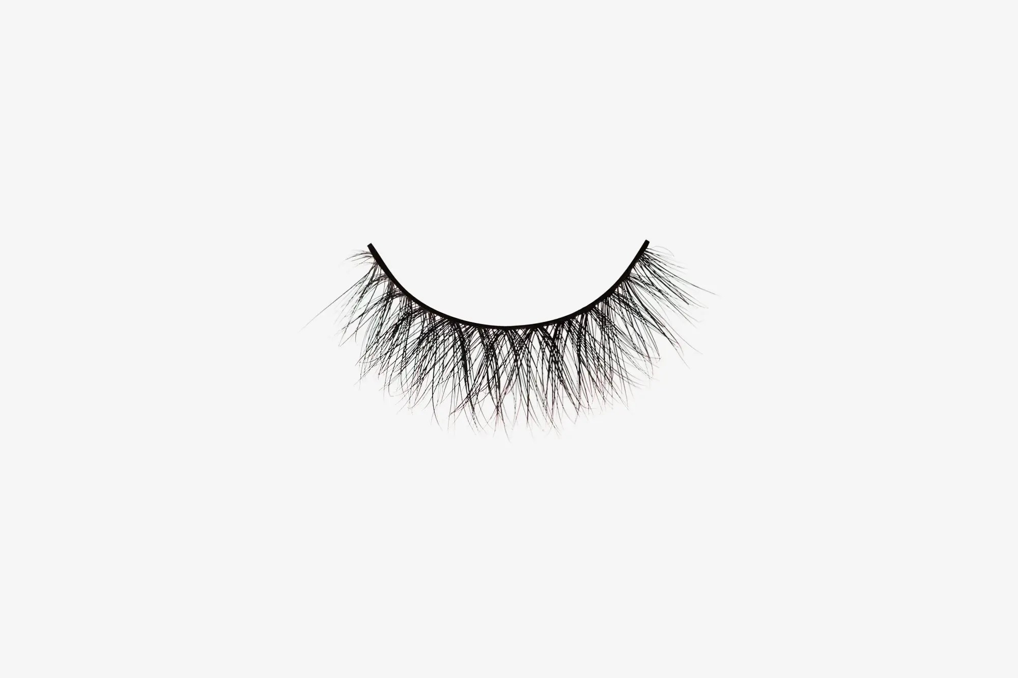 Eva Mink Lashes, single mink false lash on grey background