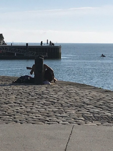 Love this image, guy on the harbour playing his guitar