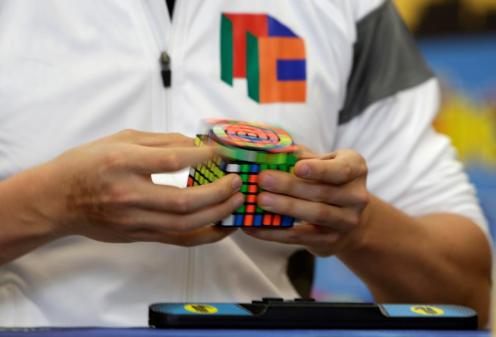 A competitor solves a Rubik's cube during the Rubik's Cube European Championship in Prague. REUTERS/David W Cerny