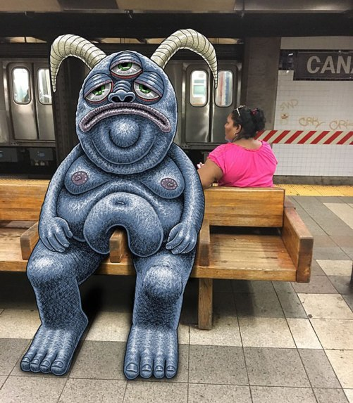 artist-adds-monsters-next-to-strangers-on-the-subway-25