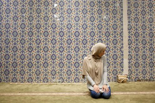 Muslim American woman takes part in afternoon prayer on the first day of Ramadan in Manhattan, New York