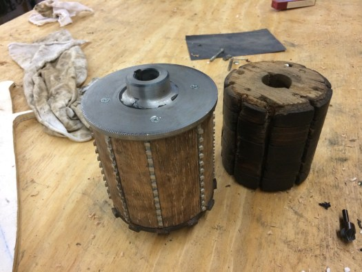 The finished apple press macerator drum beside the old drum.