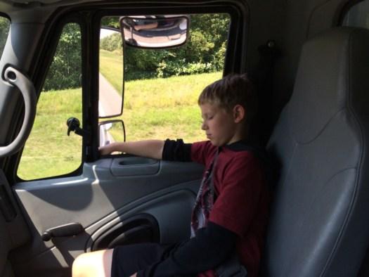 Spork riding in a big truck