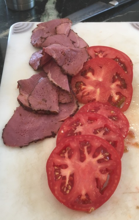 Pastrami and tomatoes cut up for lunch