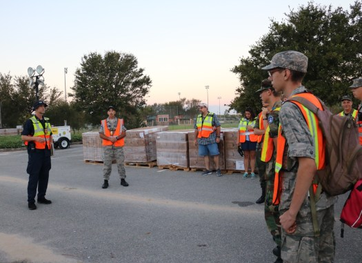 Briefing cadets, county workers, and military for the days operations