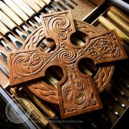 Elemental Cross - carving completed, shown with some of the tools used to carve it.