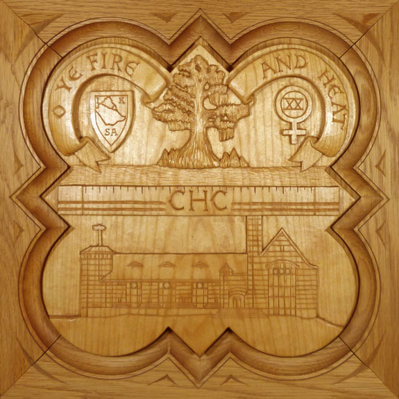 """SPS Form of 1991 Plaque, 11.25"""" x 11.25"""", stained basswood. 11.25"""" x 11.25"""", painted basswood."""