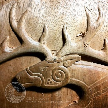 Refining hte stag's head and antlers.