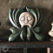 Memento Mori Green Man wood carving.