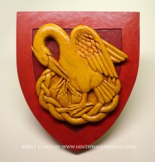 The finished pelican shield carving.