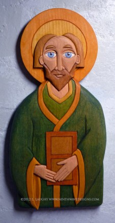 """St. Patrick carved wall hanging: 14.5"""" high by 7"""" wide by 1"""" thick. Hand carved basswood with oil stained finish."""