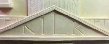 The State House tympanum with the initials MLK.