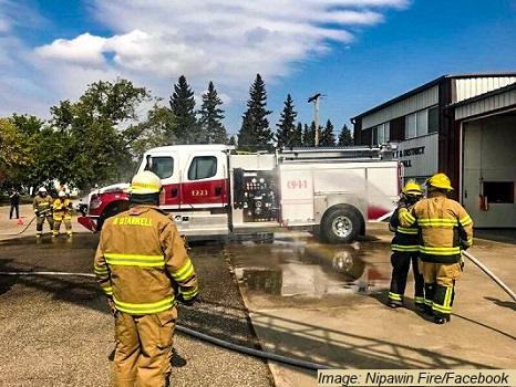 """Wet it down and Push it in"" ceremony for the commissioning of the new Melfort Fire & Rescue Fire Truck"