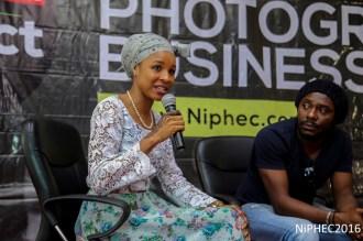 aisha augie-kuta speaking beside uche james iroha
