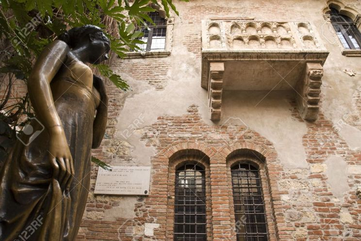 4244405-Low-angle-shot-of-statue-of-Juliet-with-balcony-in-the-background--Stock-Photo