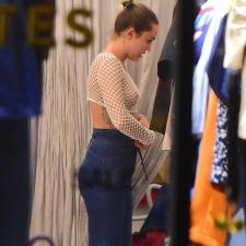 Miley Cyrus nipple slip in fishnet top trying on clothes in SOHO