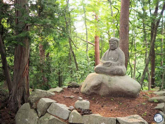 Buddhist statue in the green nature of Matsushima.