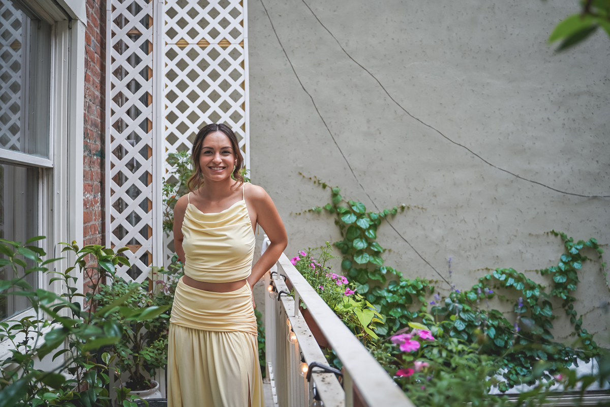 Portrait of Michelle Paltan on the 2nd floor outdoor terrace of Palma NYC restaurant.