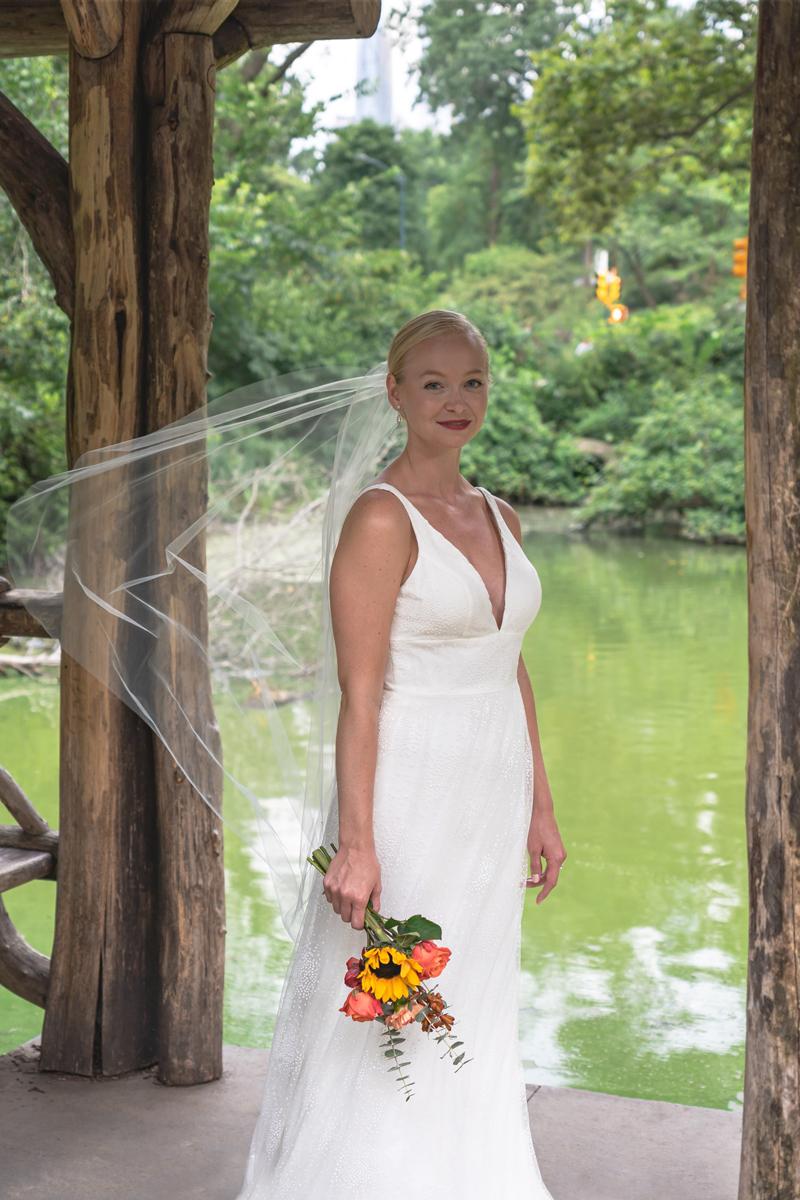 Wedding portrait of Kat Gaffney under the pavilion of Wagner Cove.
