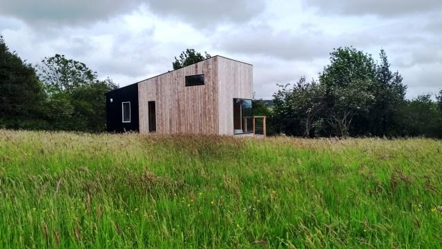 Cabin in a hay meadow