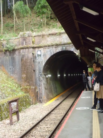 Waiting for the train to come. Please don't cross the yellow line!
