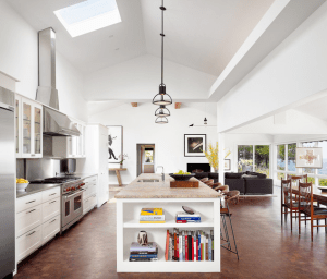 The vaulted ceiling in this kitchen makes the space grand. The added skylight adds to the space by giving it that extra light. I was drawn to it because it's so airy and spacious.
