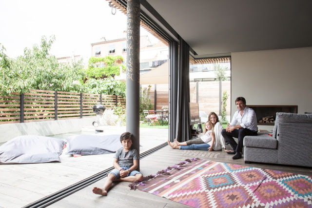 The verandah - grey with a colorful rug looks so lovely and relaxed