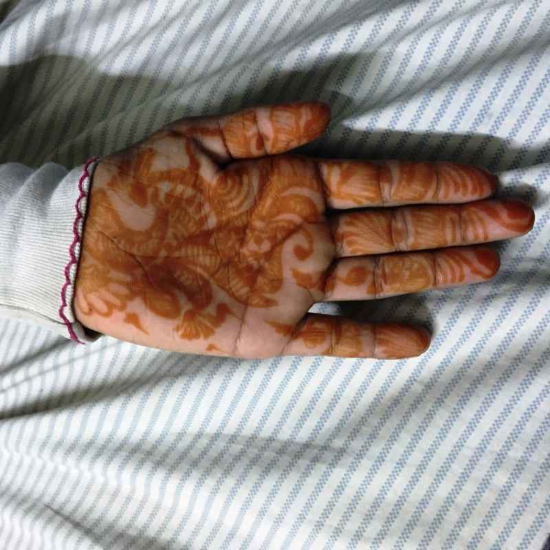 Mehendi always brings a smile to her face