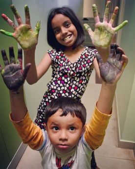 Showing off their colorful hands