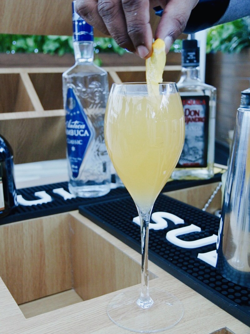 The bartender adding a finishing touch to my mimosa