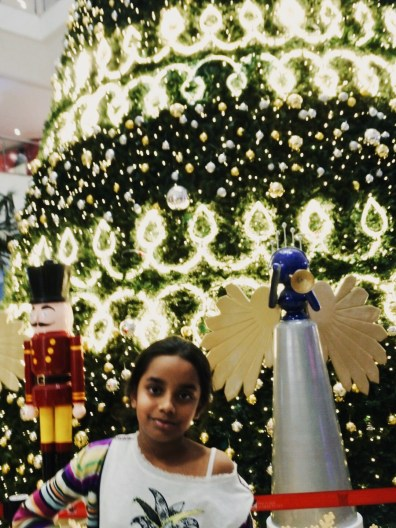 In front of the glorious Christmas tree