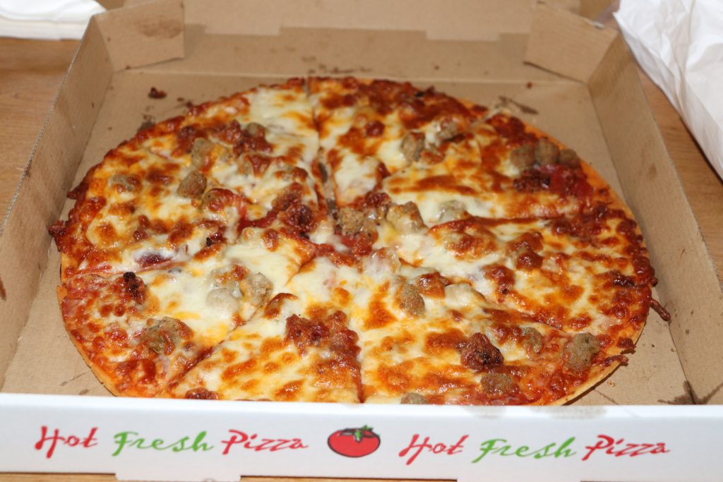 custom pizza with red sauce, cheese, traditional crust, pepperoni, and sausage