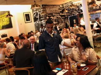 Marcus Samuelsson greeted customers at his Red Rooster Harlem restaurant. Photo: Michael Appleton, The New York Times