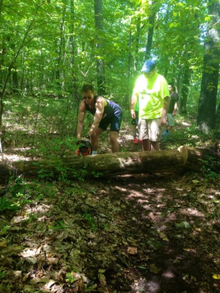 Clearing a downed tree from the trail