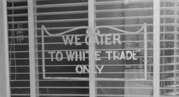 These kinds of signs have been illegal in California since the Unruh Civil Rights Act in 1959 and nationally since a 1964 U.S. Supreme Court ruling outlawed segregation. (photo ACLU Northern California)