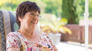 senior lady smiling and conversing