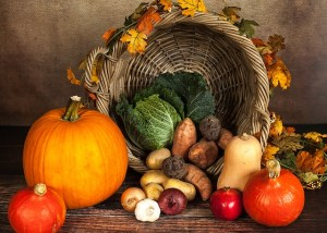 photo of fall bounty, including pumpkin, squash, mushrooms