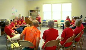 Seniors with parkinson's disease participating in therapeutic group singing session
