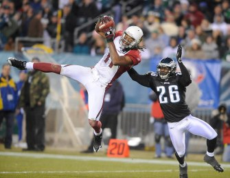 Cardinal receiver Larry Fitzgerald comes down with a reception of 40 yards as Eagles Lito Sheppard defends in the fourth quarter of November 27 2008 game at Philadelphia.