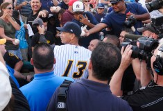 New York Yankees Alex Rodriguez is surrounded by media as he signs autographs before his rehab start with the Trenton Thunder in Trenton, New Jersey, August 2.2013 REUTERS/Scott Anderson (UNITED STATES)