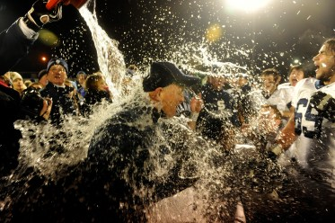 Shawnee coach Tim Gushue gets a shower after their 31-22 win over Timber Creek in Saturday's SJ Group 4 championship game at Rowan University.