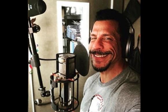 Danny Wood smiling in a recording studio