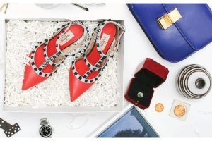 Collection of items: shoes, purse, watch