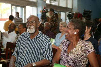 Poet Laureate Professor Emeritus Mervyn Morris and his wife, Helen, share a moment at the Press Announcement of the Poet Laureate.