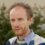 casual headshot of Dr. Koonin