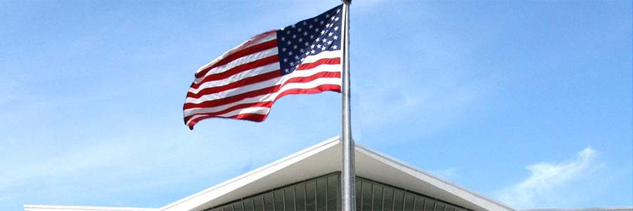 close-up of the American flag flying outside NLM