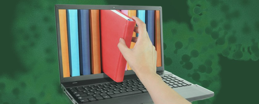 On an abstract green background. someone is removing a book from the screen of a laptop computer.